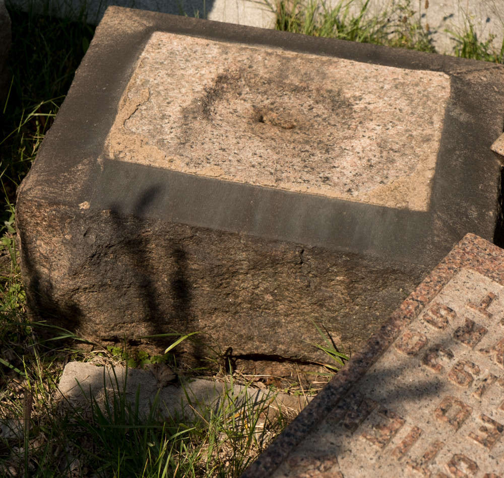 tombstone that has fallen over