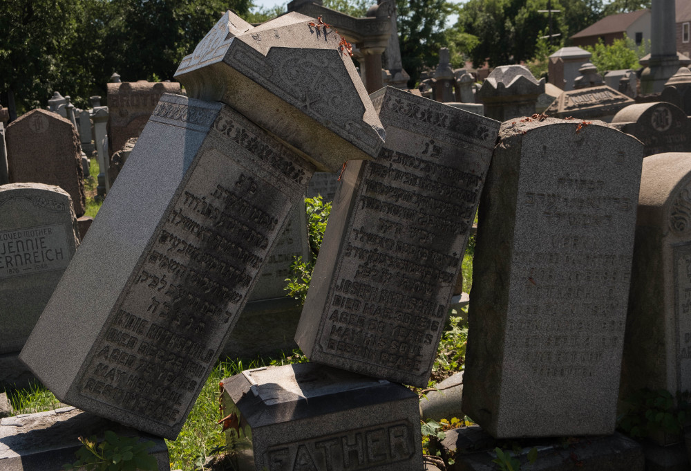 three tombstones falling over into each other